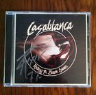 CASABLANCA - RIDING A BLACK SWAN CD SIGNED BY RYAN ROXIE IN SILVER SHARPIE
