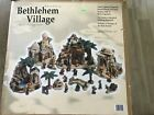 2005 SAMS CLUB LARGE BETHLEHEM VILLAGE PORCELAIN NATIVITY SET W RESIN FIGURES