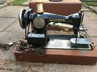 VINTAGE UNIVERSAL DELUXE SEWING MACHINE WITH CASE