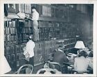 1950 Photo Library Books Shelter Signs Hanging Tables People Vintage Image
