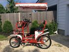 Surrey Deluxe 4 Wheel Bicycle Pedal Car 7 speed International Surrey Company red