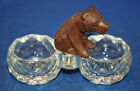 A well carved antique Victorian Black Forest sitting bear figure glass dishes