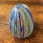Latticino Glass Egg Paperweight with Colorful Ribbon Twists