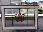 OLD ENGLISH LEADED STAINED GLASS WINDOW WITH TULIP SHAPED FLOWER IN THE CENTER