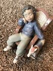 Lladro Spain Figurine #5846 All Tuckered Out boy in chair with toy horse w/o box