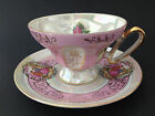 Arnat Japan cup and saucer pink lustre finished gold gilts courting scene roses