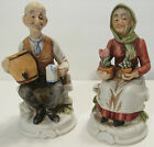 Pair of Ceramic Old Man and Old Woman Each Sitting on a Bench Figurines