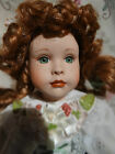 Porcelain doll Red hair music box overlooking the four leaf clover Patricia Rose