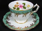 AYNSLEY GREEN FANCY GOLD FLORAL EMBOSSED TEA CUP AND SAUCER