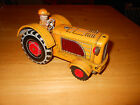 Cragstan tin friction powered tractor made in japan spark toy