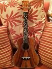 'A Super Tenor Ukulele with Dragon Inlays, pickup, and case