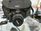 NIKON D5100 w VR DX AF S 18 55 lensNikon Bag strapbattery and charger