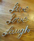 White metal words live love laugh