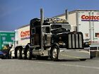 1 64 DCP BLACK 389 PETERBILT TRI AXLE W 70 SLEEPER