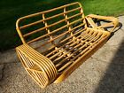 Mid century rattan sofa and coffee table in the style of Paul Frankl