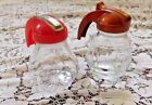 TWO VINTAGE FEDERAL GLASS SYRUP PITCHERS RED AND COPPER