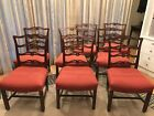 EIGHT UPHOLSTERED CHIPPENDALE STYLE VINTAGE MAHOGANY LADDER BACK DINING CHAIRS