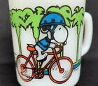 ANCHOR HOCKING SNOOPY MILK GLASS COFFEE MUG PEDAL POWER BICYCLE SCHULZ-NICE !