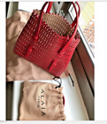New Alaia leather lazer cut tote framboise red removable adj strap with tags
