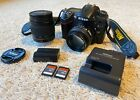 Nikon D7000 162MP Digital SLR Camera bundle w 50mm 114D  28 80mm G lenses