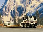1 64 DCP WHITE FONTAINE RENEGADE TRI AXLE STRETCH LOWBOY TRAILER