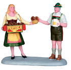 Lemax Christmas Village Carnival Lady Vendor offers Pretzel Snack to Man w/Beer
