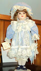 SOFT EXPRESSION PORCELAIN DOLL IN BLUE DRESS AND HAT with pink roses