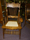 Antique Oak Pressed back arm chair w/cane seat rope twist spindles Refinished