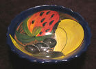 Small 3 footed ceramic bowl with brightly colored fruit design