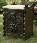 antique carved oak bench seat or hall chair with Griffin and Green Man carvings