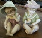 A PAIR OF VINTAGE PORCELAIN BISQUE GIRL AND BOY  PIANO BABIES