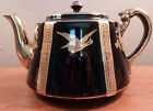 Vintage luxurious Gibson's black teapot with textured gold flowers and birds