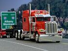 1 64 DCP RED 389 PETERBILT TRI AXLE W 70 SLEEPER
