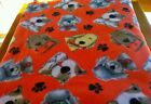 FLEECE FABRIC DOGS AND PAWPRINTS ON RED 2 YARDS