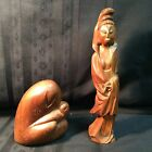 Wood carvings; Folk art of two women; one with child; the other a Goddess