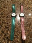 Lot of 2 DKNY women's watches with genuine leather bands:One blue/teal, one pink