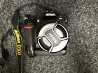 Nikon D300 Camera With A 18-105mm Lens And A Multi Power Battery Pack