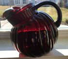 Vintage Fire King Ruby Red 3qt Swirled Tilt Ball Pitcher in Excellent Condition.