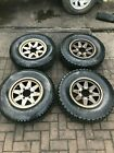 4 x ALLOY WHEELS WITH GOOD A T TYRES  8MM TREAD  for MITSUBISHI DELICA L400