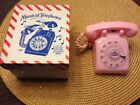 VINTAGE PINK TELEPHONE MUSIC BOX TELEPHONE PLAYS ALOUETTE NIB RARE Swiss Movemen