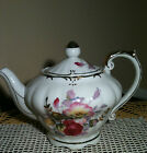 vintage porcelain teapot made in japan Tilso musical teapot gold trim