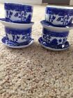 Four Small Saucers And Small Cups And Blue-And-White Nature Print