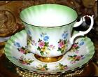 ROYAL ALBERT FLORAL CHINTZ LIME GREEN TEA CUP AND SAUCER BONE CHINA