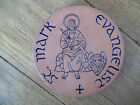 FRANKOMA ROUND BROWN CERAMIC POTTERY ST. MARK EVANGELIST TRIVET