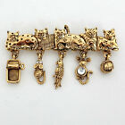 Gold plated brooch in shape of 5 CATS with dangling charms, signed A.... Lot 15D