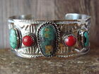 Native American Jewelry Nickel Silver Turquoise and Coral Bracelet by Bobby Clev