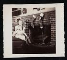 Antique Photograph Little Girl Holding Baby By Christmas Stockings on Fireplace