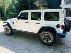 2018 Jeep Wrangler  Rubicon Unlimited Sport Utility 4-Door White with Black Interior Dual Body Group