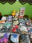 2 Ty Beanie Kids Angel and Rascal and 24 complete outfits.