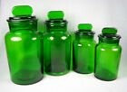 Set Of Four Graduated Green Glass Apothecary Stoppered Canister Jars
